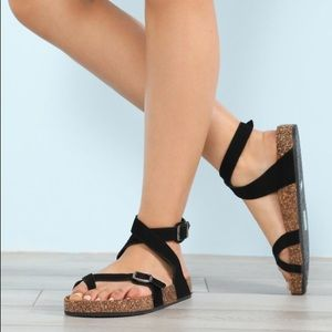 Ladies ankle buckle strappy flat sandals. Black